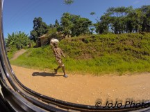 Road photo of Ugandan man (enroute to Bwindi)