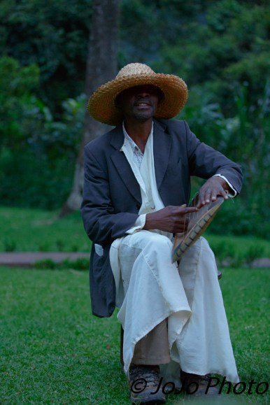 Mr. Warren, a African harpist, at Sanctuary Gorilla Forest Camp in Bwindi