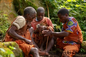 Batwa Pygmies making fire in Bwindi National Park