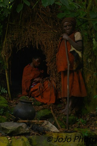 Batwa Pygmy weaving basket in Bwindi National Park