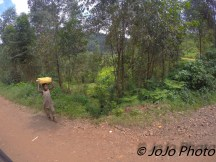 Ugandan child hauling water