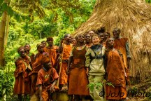 "Mary (4'8"") poses with Batwa Pygmy Tribe in Bwindi National Park"