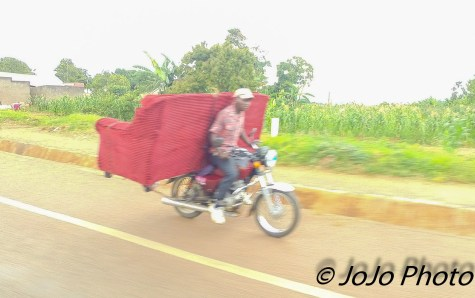 Man Transporting Loveseat