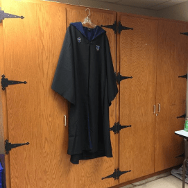My Ravenclaw Robes on my castle gates closet