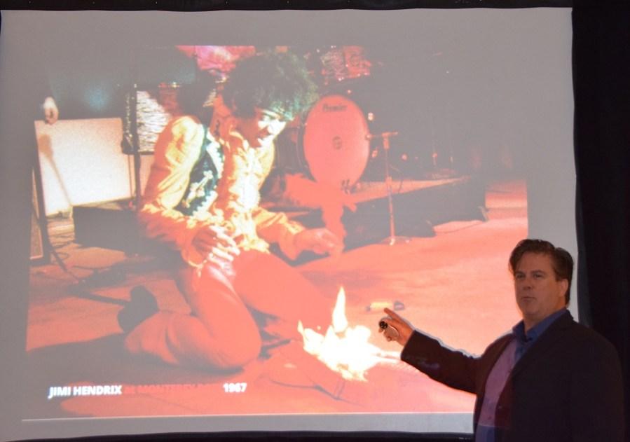Richard McDonald of Fender Music shows slide of Jimi Hendrix