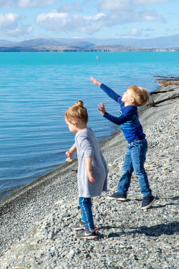 Kids throwing rocks in Lake Pukaki