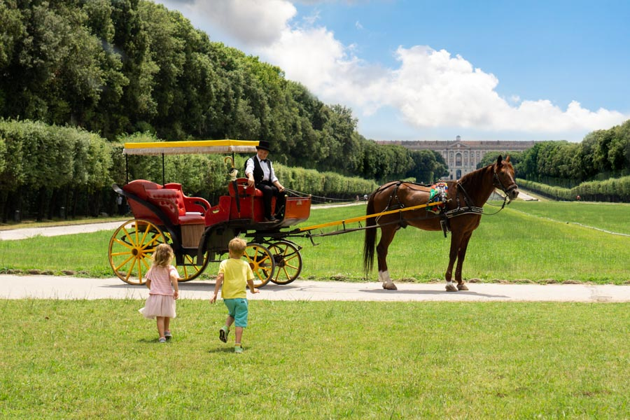 Caserta Palace kids running to horse and carriage