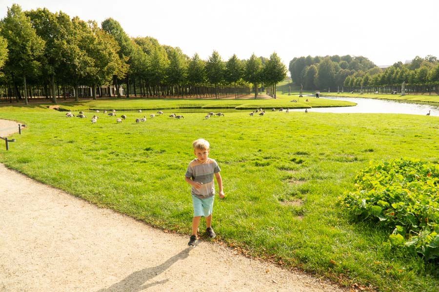 Boy playing in Schwerin Castle garden