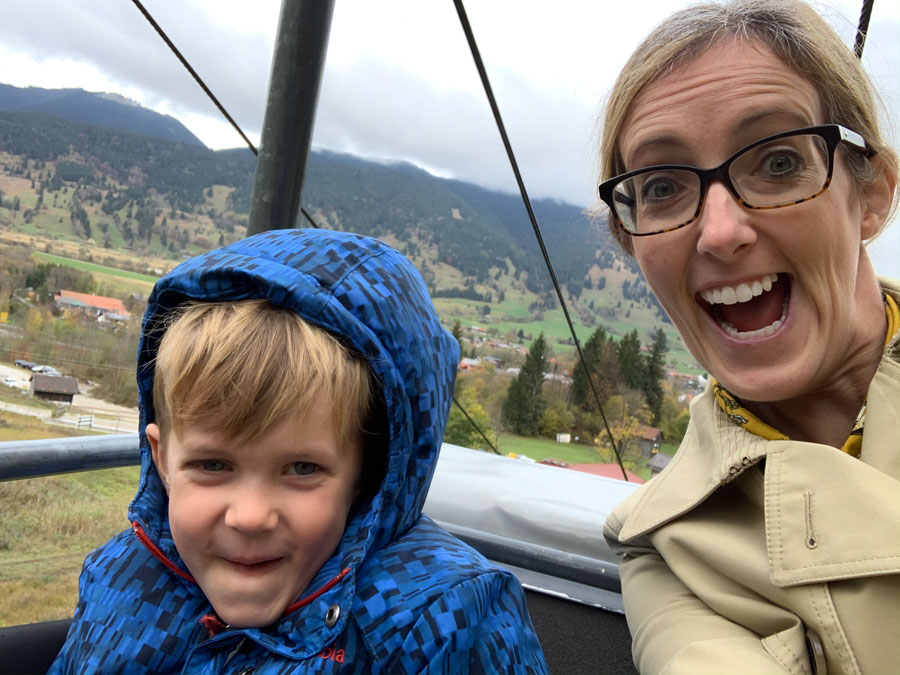 mom and son on chairlift