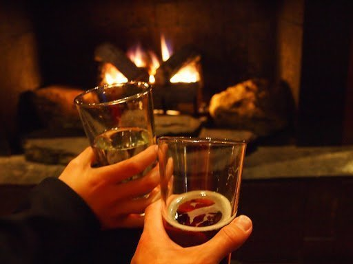 Beer and fireplace during a winter night
