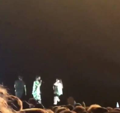 Yikes! White Fan Raps N-Word on Stage w/ Kendrick Lamar Before He Interrupts To Correct Her [Video]