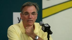 billy beane responds to a question during a press conference