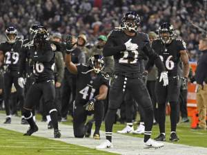 tony jefferson celebrates an interception for the ravens defense who are an under-the-radar pick for your daily fantasy lineup in week 1