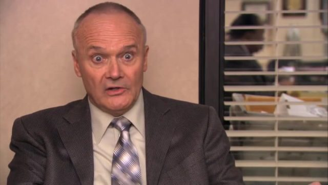 creed bratton looking crazy and wild.