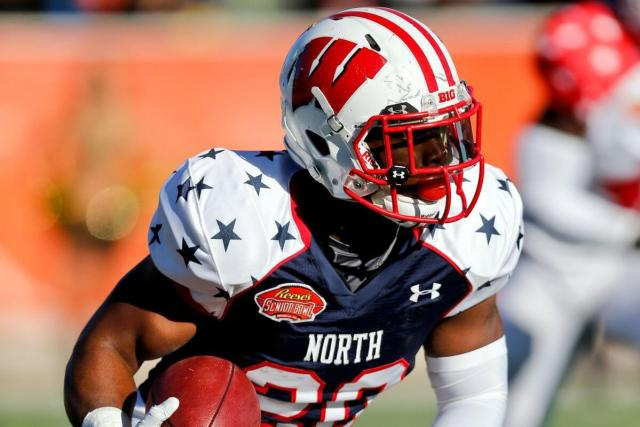 James White carries the ball in the 2014 Senior Bowl, looking to up his stock before the 2014 NFL Draft.