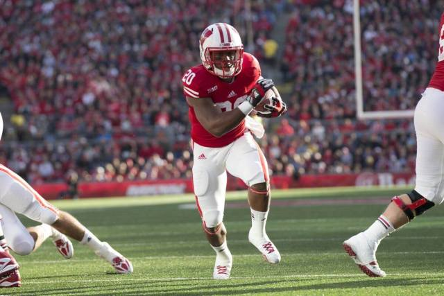 James White carries the football for the Wisconsin Badgers in 2013.