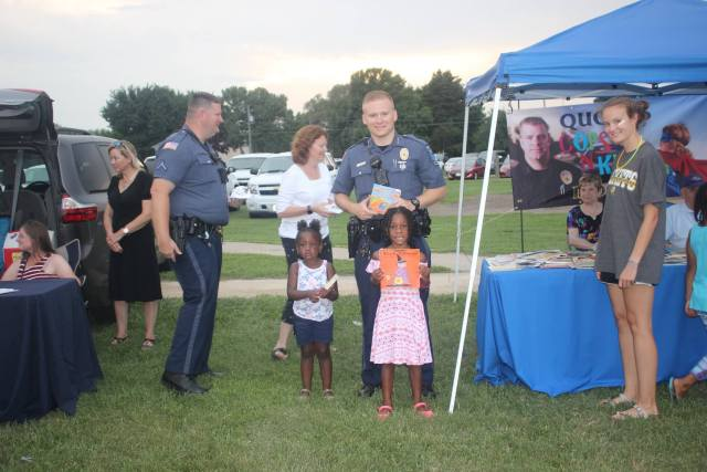 Officer Spencer Wiersberg helps out at a community event in Fruitland, Maryland