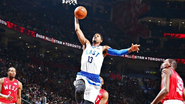 Paul George leaps to the basket during the 2016 NBA All-Star Game, just two years removed from a devastating right leg injury.