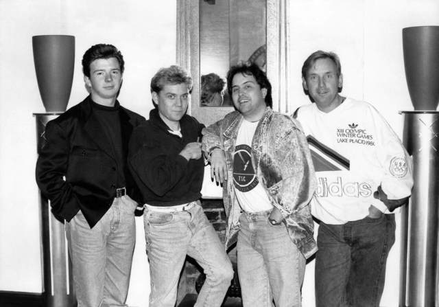 Singer Rick Astley with record producers Mike Stock, Matt Aitken and Pete Waterman in December 1987