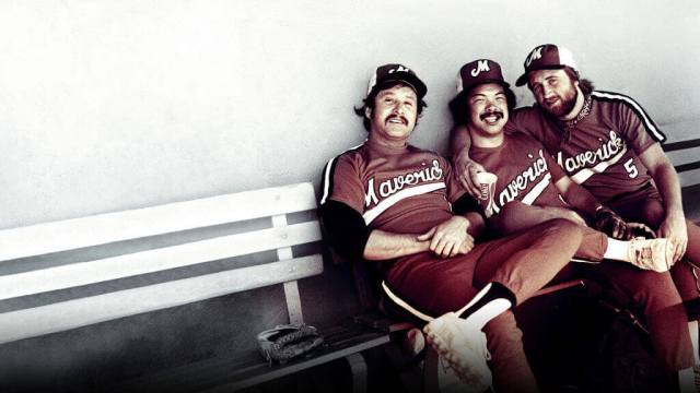 Portland Mavericks teammates, including Jon Yoshiwara (middle), hang out in the dugout in the 1970's, pulled from the Netflix documentary 'The Battered Bastards of Baseball'.