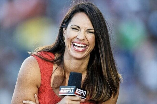 Jess Mendoza laughs at the haters while working for ESPN on an MLB field