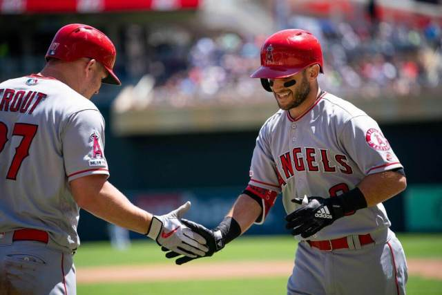 Tommy La Stella high-fives Mike Trout after blasting a home run into the right field seats during the 2019 MLB season.