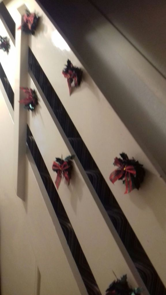 Christmas decorations on a budget. These I did on the stairs using fabric bows and tinsel decorations.