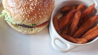 Frankie and Benny's style burger with side of sweet potato fries