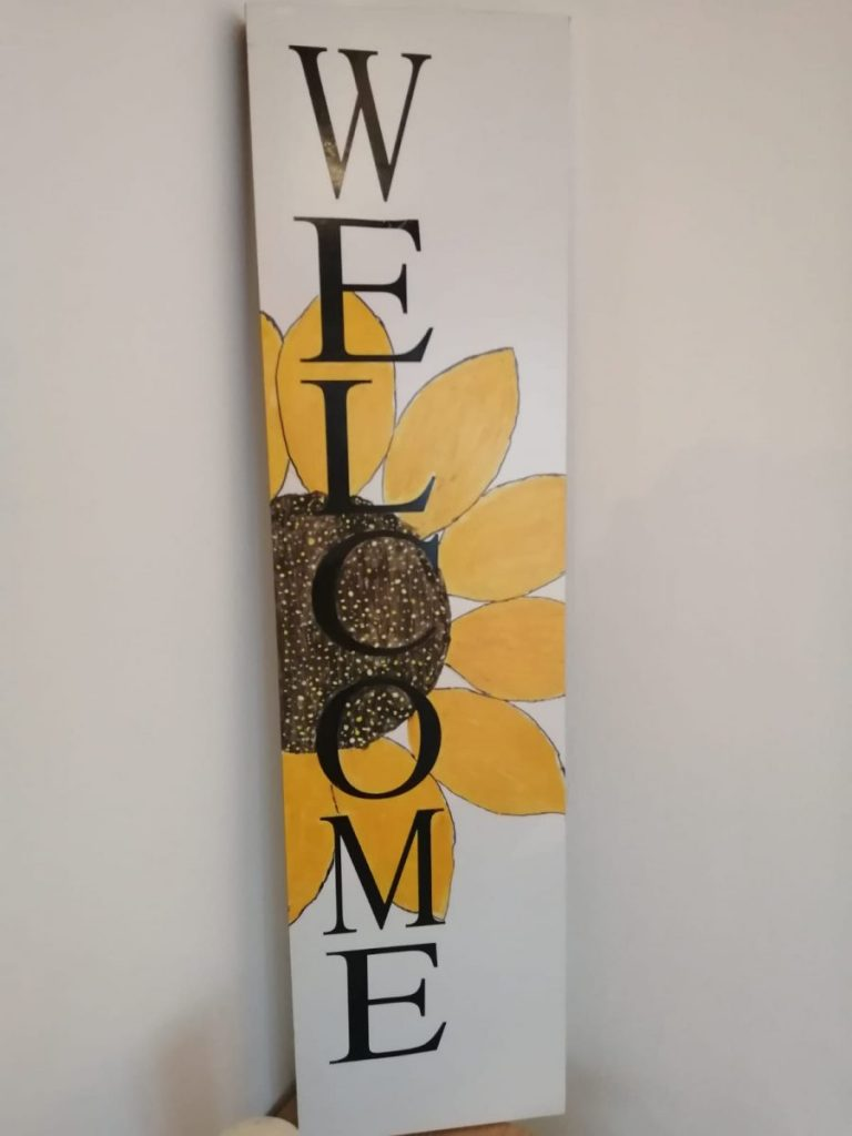 A wooden sign that says welcome