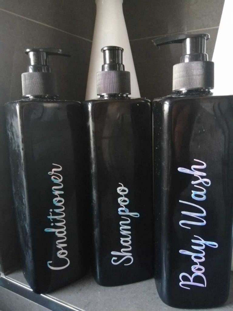 Pump bottles that have been decorated for use in the bathroom.