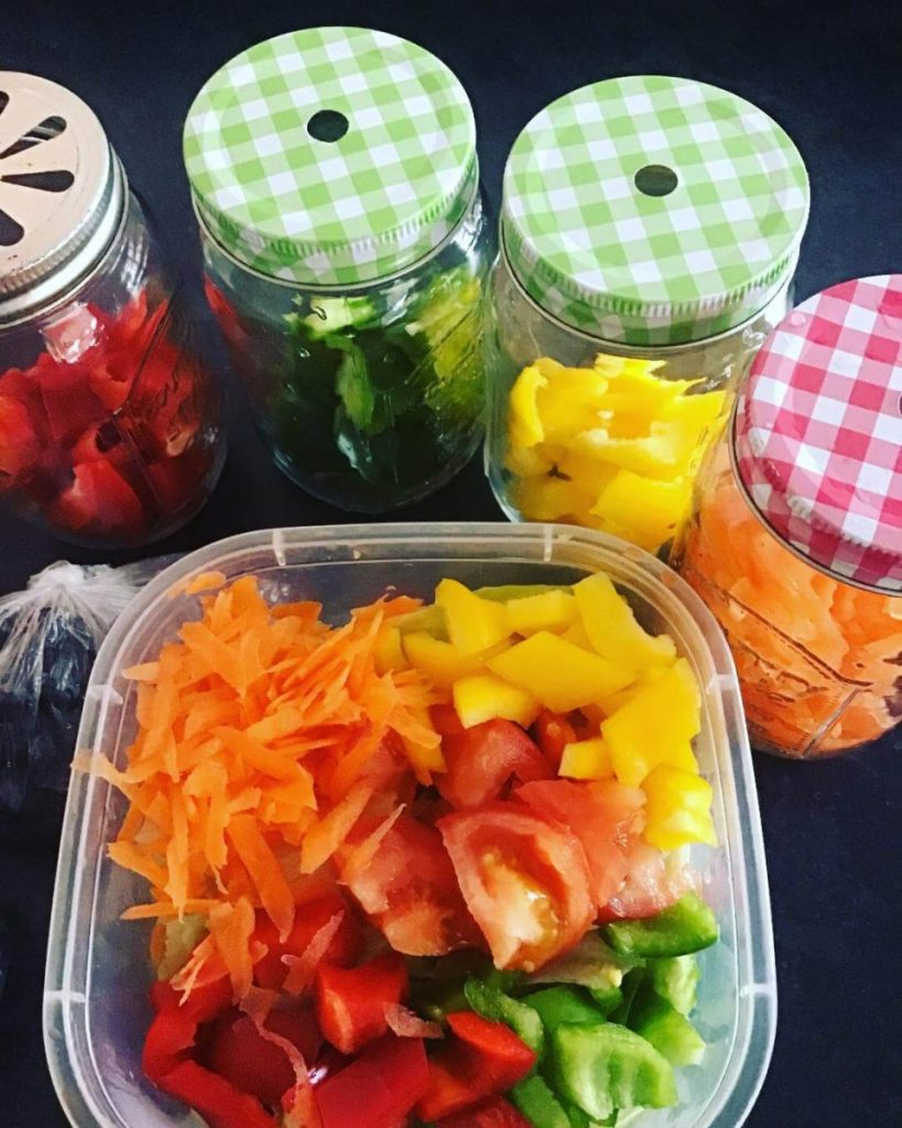 coloured vegetables all prepared and in jars