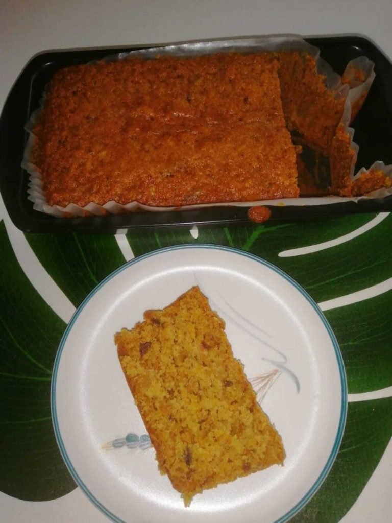 A moist carrot cake and a slice in a plate