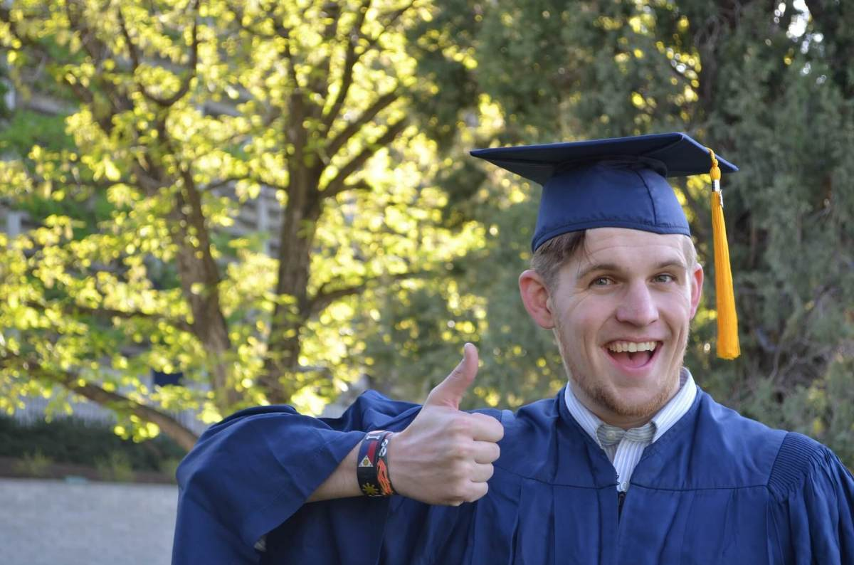A man in his graduation gown.
