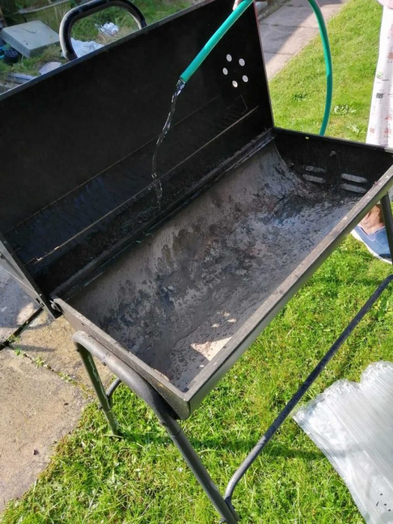 a photo of a BBQ being washed as part of frugal things to do in September.