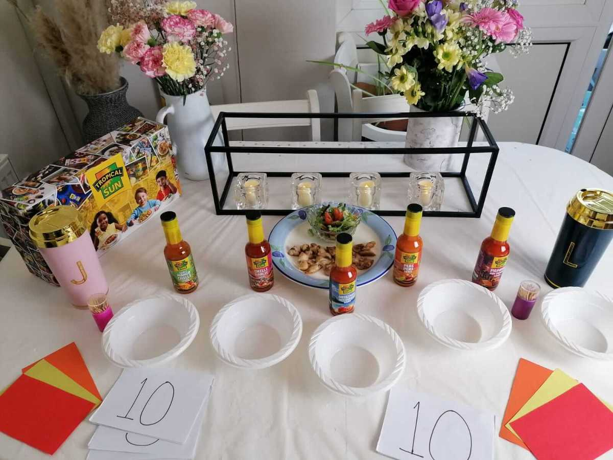 a table set up to taste test some hot sauces