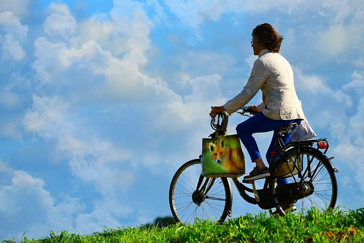 a woman riding a bike