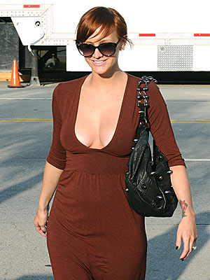 ashlee_simpson_pregnant_boobs_tattoo.jpg. Photos from People.com