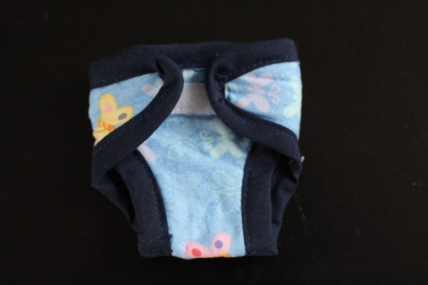 Couche papillon fond bleu