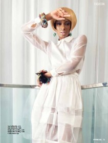 """Jolita feature in Pride Magazine June 2013 editorial """"White Lights"""". A model is wearing a white dress and two statement bangles made by Jolita Jewellery: Tribal Couture Ganesha and Flower and Skull bangle, made with new and reclaimed components."""