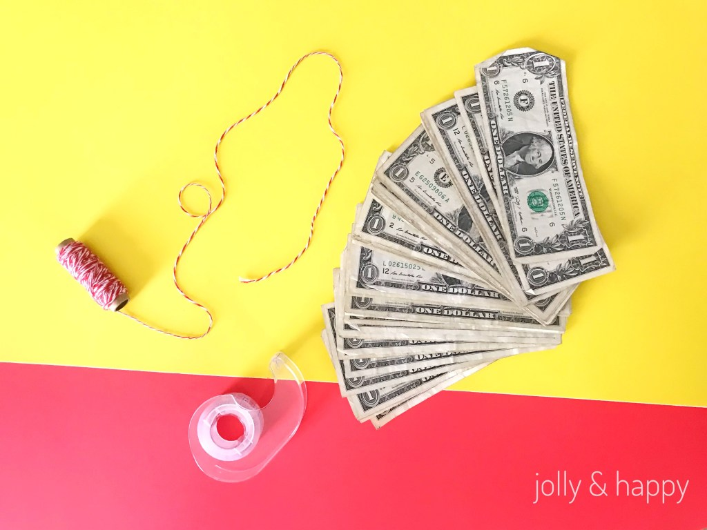 Basic supplies are dollar bills, string and tape