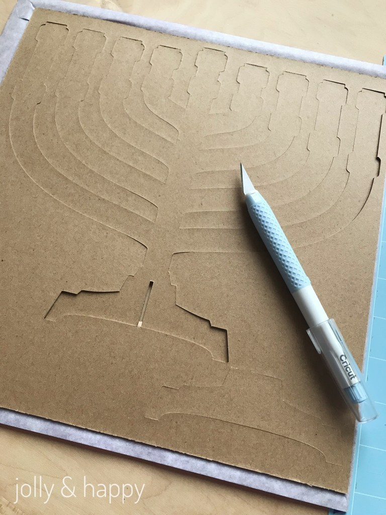 Use the Cricut True Control knife to help take out the menorah