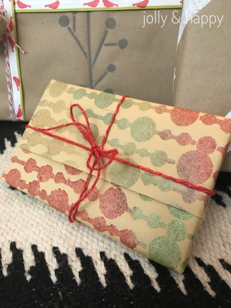 DecoArt paints and stencils to create many colors and textures on wrapping paper