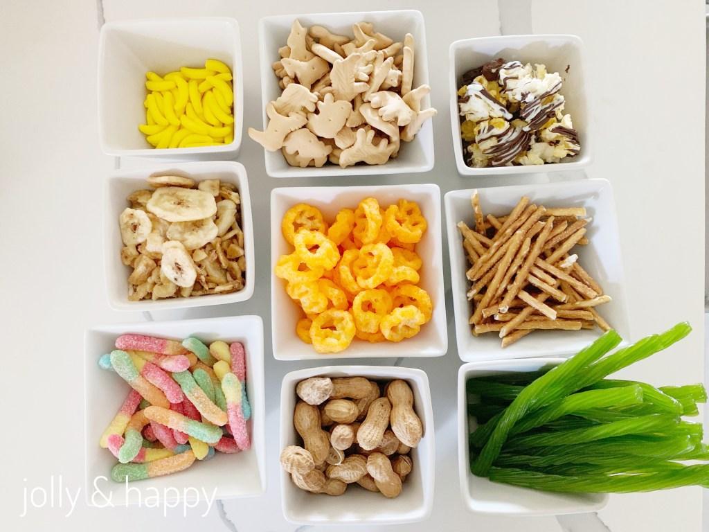 runts, animal cracker, banana chips, Cheetos, popcorn, gummy worms