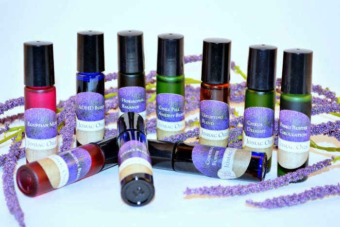 JOMAC Oils special essential oil blends ADHD Blend, Hormonal Balance, Chill Pill Anxiety Buster, Uplifting Blend, Citrus Delight, Fibro Buster Circulation, Peaceful Blend, Levae's Blend, and Cortisol Buster in roll-on bottles.