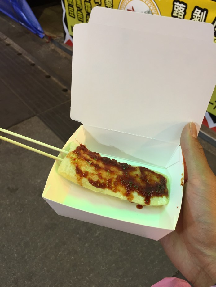 Grilled mochi with spicy sauce.