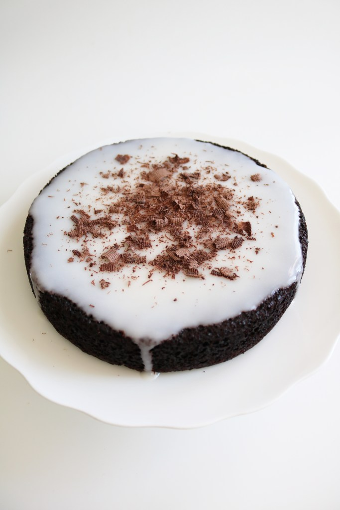 Vegan chocolate cake with coconut yogurt glaze.