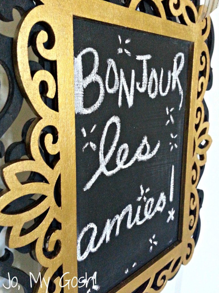 Create this easy and inexpensive gilded chalkboard sign for your front door-- a welcome change from a wreath!