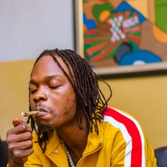 The Nigerian lady who tattooed the face of Nigerian singer cum rapper, Naira Marley on her laps has been seen in a new video, in tears after the singer acknowledged her action with a gesture on social media.