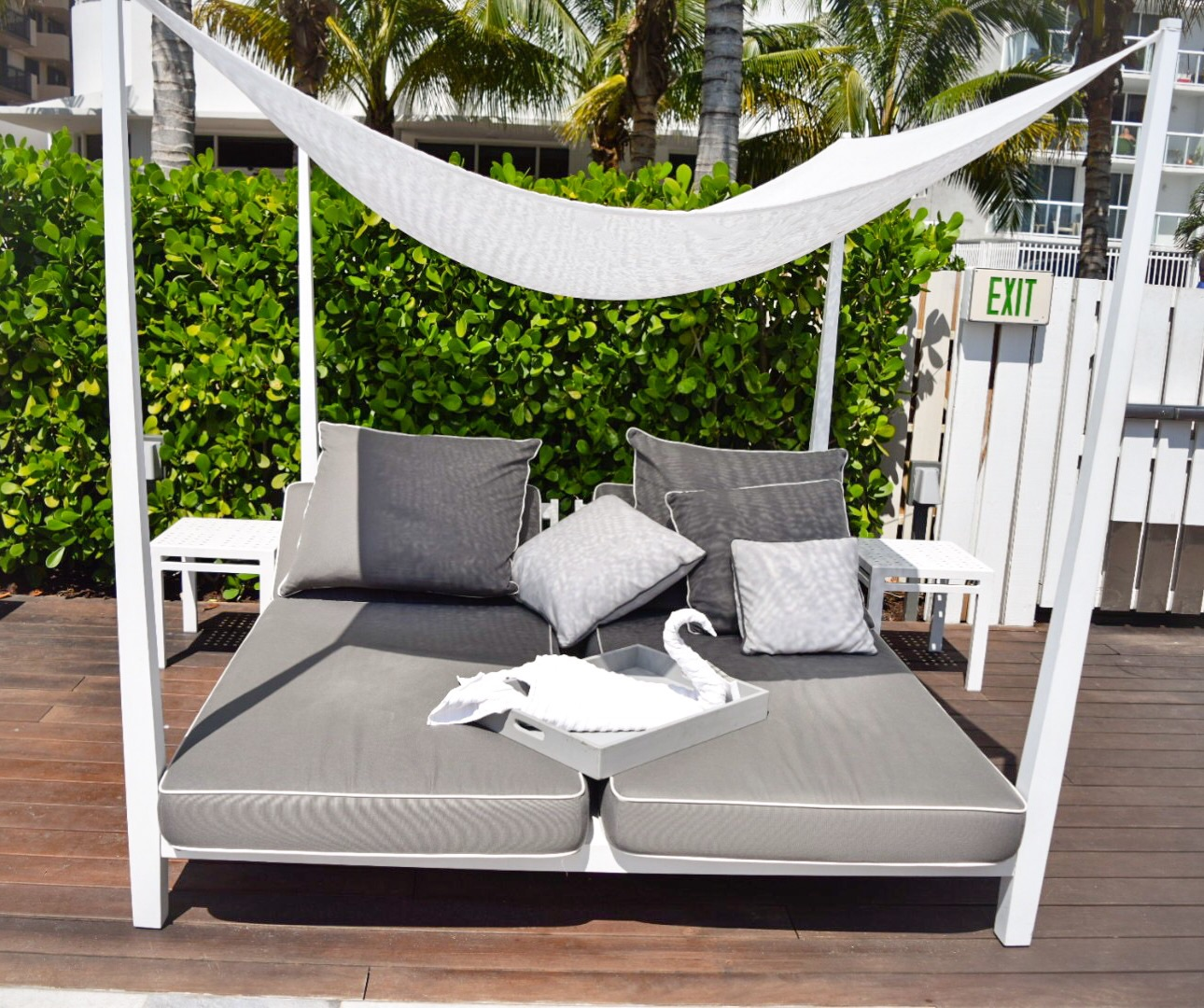 miami metropolitan by como – an urban retreat in the city – jona  - there were more four poster beds in a shaded area with palm trees just bythe gate access to the beach