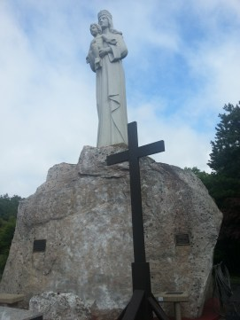 Mary and Jesus stand atop of the boulder at the Shrine of Our Lady of the Island in Manorville, N.Y., on Sunday, July 10, 2016.
